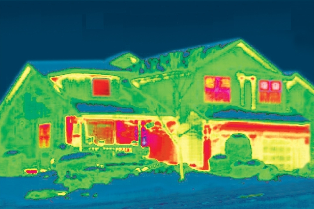 Infrared picture of house in winter showing energy loss
